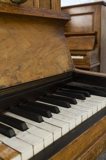used piano vs new piano