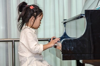 practicing piano musical alphabet